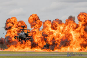 Apache in front of a wall of fire